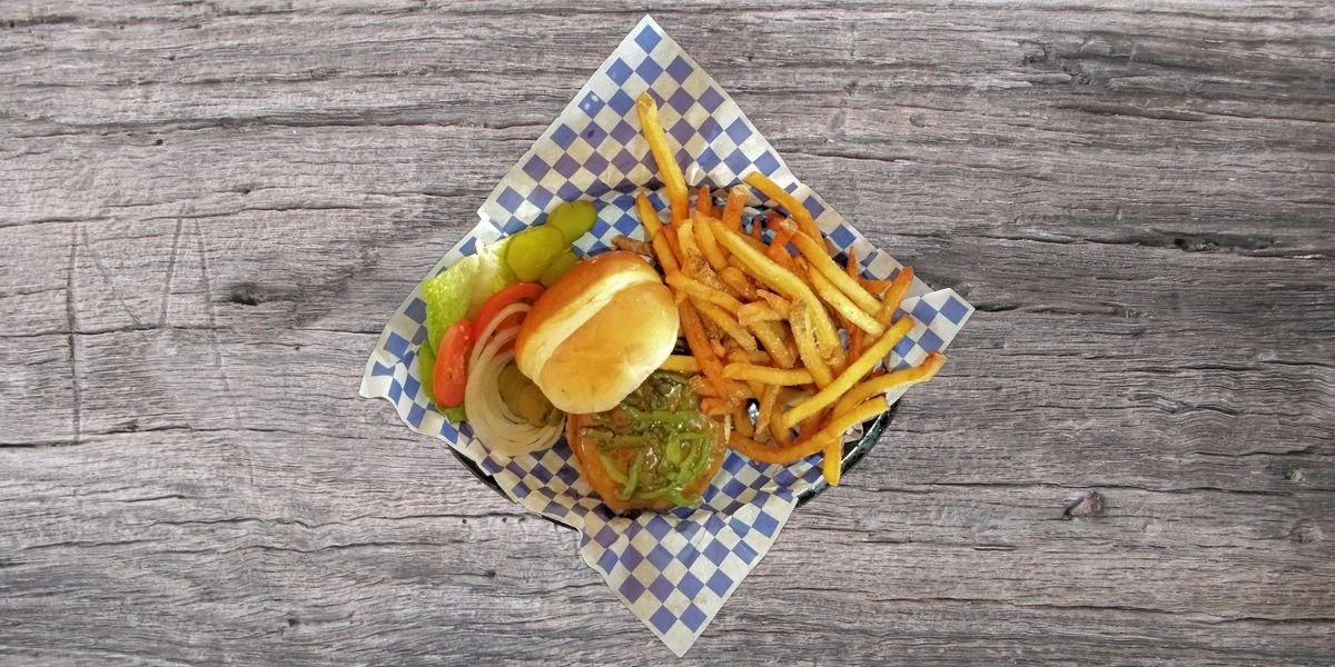 Smoken Moe's Unreal BBQ Menu - Green Chili Cheeseburger
