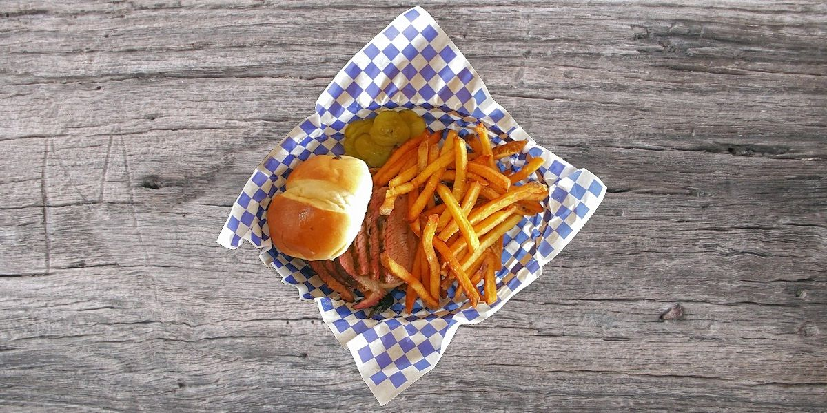 Smoken Moe's Unreal BBQ Menu - Sliced Smoked Brisket Sandwich